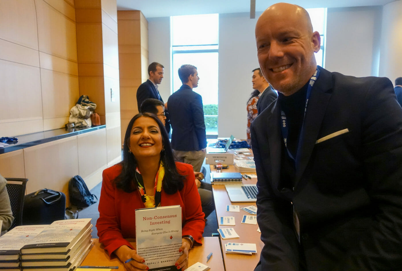 """Swem Lorenz and Rupal Bhansali at the book table with the book """"Non-consensus investing"""""""